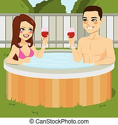 Couple On Jacuzzi - Young couple enjoying outdoor jacuzzi...