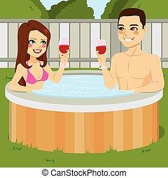 Couple On Jacuzzi - Young couple enjoying outdoor jacuzzi...