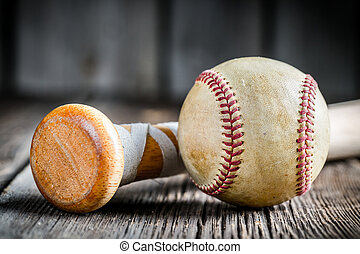 Baseball ball and a wooden stick