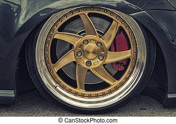 Close-up of aluminium rim of luxury car wheel