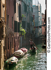 Gondolier Floating in a canal in Venice