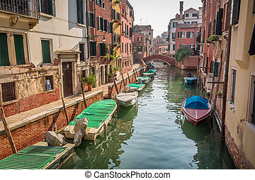 Boats and motorboats on a canal in Venice
