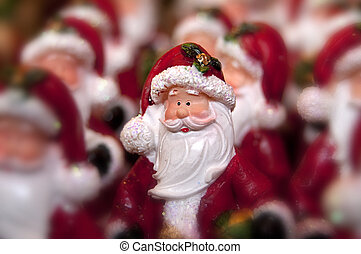 Santa clause - Many little statue of santa clause and one in...