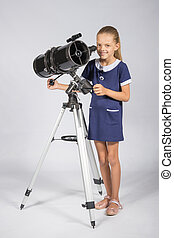 The young astronomer sets up a telescope and looked into the...