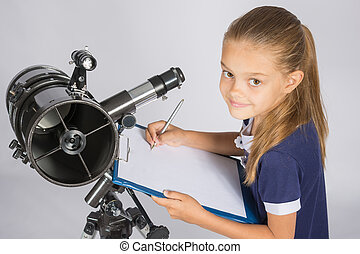 Young Astronomer writes the results of observations in the document