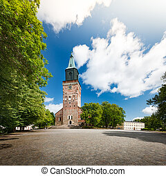 Turku Cathedral on sunny day with blue cloudy sky in...