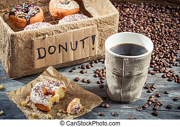 Box full of donuts with coffee