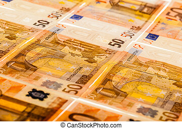 Euro bills side by side - a lot of fifty euro banknotes...