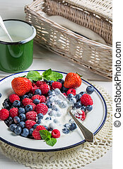 Closeup of berry fruits with cream