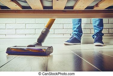 woman makes cleaning the house people vacuums the floor