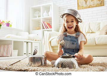 girl playing with utensils - cute little child girl playing...