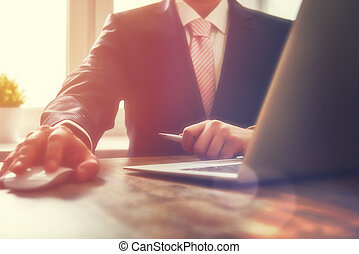 Business man working at office with laptop