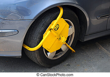 Wheel Lock - Wheel lock attached for illegal parking in...