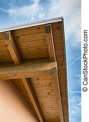 Wooden beams - Corner of house with wooden beams against...