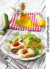 Italian lunch: chicken with mozzarella ,spaghetti and zucchini