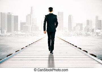 Businessman walking on pier - Businessman walking on wooden...