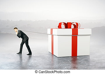 Businessman dragging present - Businessman dragging huge...