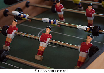 Tabletop foosball game with red and yellow figures