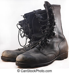 combat boots - Used black leather combat boots in front of...
