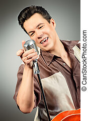studio records - Professional male musician plays and sing...