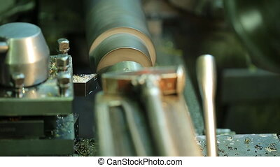 Milling metal spinning parts of machine closeup. Removing...