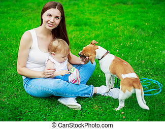 mother, baby and dog - happy young mother with baby and her...