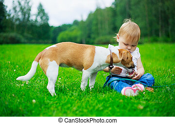 bbay with a dog - cute baby with a dog in the summer park