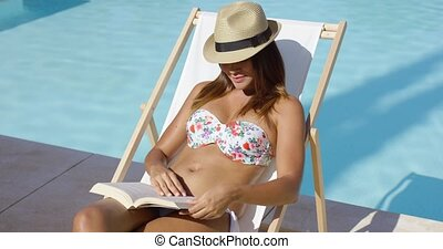 Young woman in a trendy hat relaxing in the sun - Young...