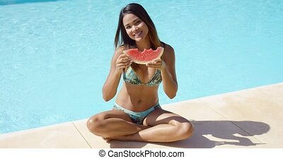 Cute bikini clad woman eating watermelon - Cute bikini clad...