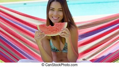 Cheerful woman in bikini eating watermelon slice - Cheerful...