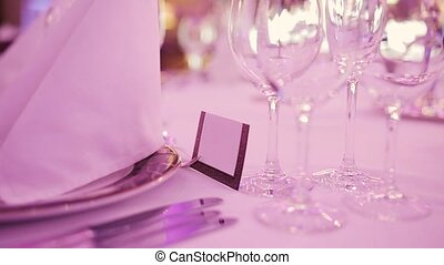 Served restaurant table Plate, wineglasses and napkin Pan...