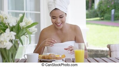 Woman wrapped in towel holding orange slices - Single...