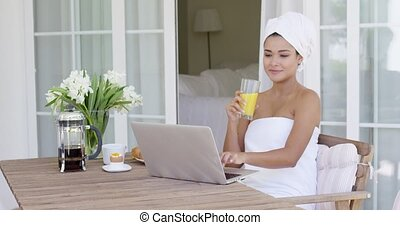 Beautiful woman in bath towel using laptop - Beautiful woman...