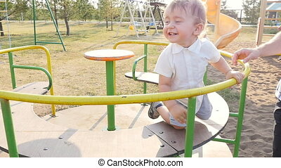 Happy father and son playing together having fun in the park...