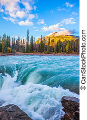 Scenic Athabasca Falls in Jasper National Park. Emerald...