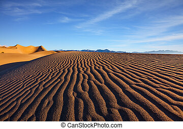 Bright sunny morning - Mesquite Flat Sand Dunes. Bright...