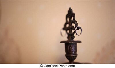 rings on an old candlestick