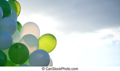 Balloons over a clear blue sky. - Balloons over a clear blue...
