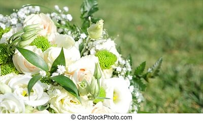 bridal bouquet lying on green grass