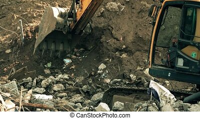 Operating excavator and debris. 4K long shot - Operating...