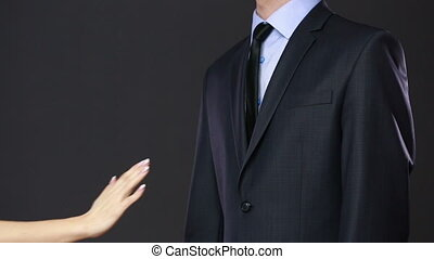 Girl pulls a man for a tie. concept of seduction