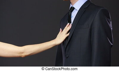 Girl pulls a man for a tie. is refused. concept of seduction