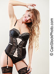 Smiling girl wearing sexy lingerie - Sexuality concept....