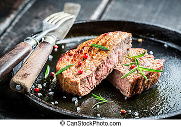 Hot roasted beef with fresh herbs ready to eat