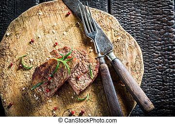 Roasted hot steak with herbs and spices