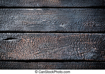 Closeup of burnt wooden fence