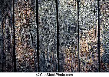 Black burnt wooden fence