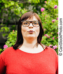 pretty modern mature fat woman outside wearing glasses,...