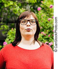 pretty modern mature fat woman outside wearing glasses,...
