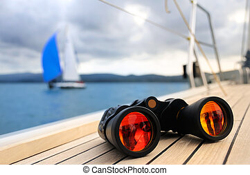 Binocular on the deck of yacht - Close up on binocular on...